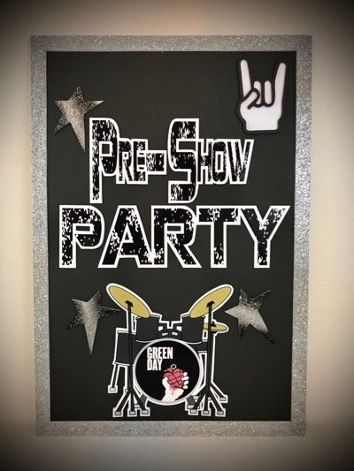 pre show party welcome sign with a drum set
